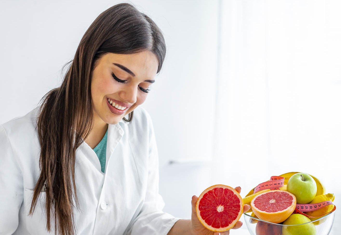 Portrait of young smiling female nutritionist in the consultation room